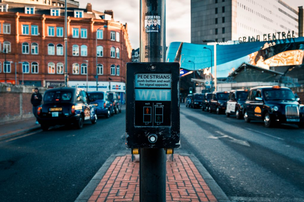Photo of a pedestrian crossing with a taxi rank in the background
