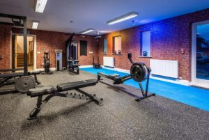 Photo of inside Elysium Tarporley Gym showing various equipment
